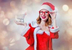 Santa Clous girl with shopping cart Stock Photography
