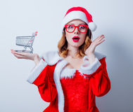 Santa Clous girl with shopping cart Stock Photo