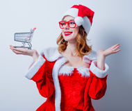 Santa Clous girl with shopping cart Royalty Free Stock Images