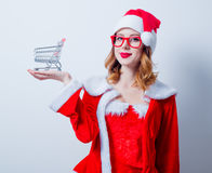 Santa Clous girl with shopping cart Stock Image