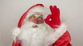 Santa say ok on grey background stock footage