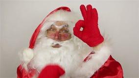 Santa say ok on grey background stock video footage