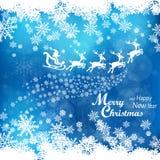 Santa Clouse driving sledge in blu Royalty Free Stock Photo