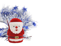 Santa Clouse figurine. Whith silver tinsel Royalty Free Stock Photo