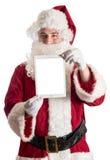 Santa com tabuleta Fotos de Stock