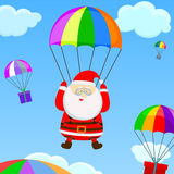 Santa com um paraquedas Imagem de Stock