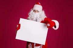 Santa com uma placa Imagens de Stock