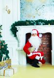 Santa comes to the house. On the Christmas Eve, photo in the interior Royalty Free Stock Images