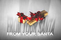 SANTA IS COMING writing and a red bow royalty free stock images