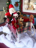 Santa is Comming. Santa and friends on the porch Royalty Free Stock Images