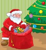 Santa con el bolso de regalos Imagen de archivo libre de regalías