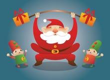 Santa con gli elfi ed i presente Immagine Stock