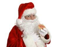 Santa con il biscotto di natale Fotografia Stock