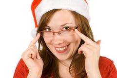 Santa con il cappello e spec. rosse Fotografie Stock