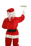 Santa con il rullo di vernice fotografia stock