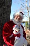 Santa con il suo cane Immagini Stock Libere da Diritti
