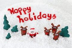 Santa con l'albero di abete e della renna su neve Immagine Stock
