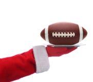 Santa con la bandeja del fútbol americano fotografía de archivo