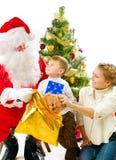 Santa con los niños Imagen de archivo