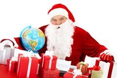 Santa con los presentes Imágenes de archivo libres de regalías