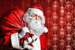 Santa con los presentes Foto de archivo