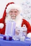 Santa con los regalos de la Navidad Imagen de archivo