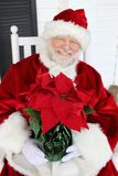 Santa con un Poinsettia Fotografia Stock Libera da Diritti