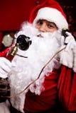 Santa con un telefono Fotografie Stock Libere da Diritti