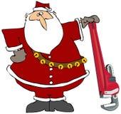 Santa con una llave de tubo gigante Foto de archivo