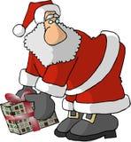 Santa con una nariz grande y un regalo envuelto Imagenes de archivo