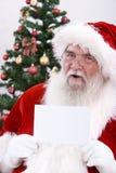Santa con una tarjeta blanca Imagen de archivo