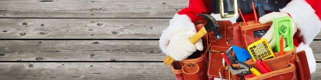 Santa with construction tools Stock Photo