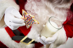 Santa with cookie and milk Royalty Free Stock Photography