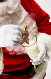 Santa with cookie and milk Royalty Free Stock Photo