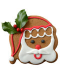Santa cookie on red and white background. Festive Santa cookie on white background Stock Photos