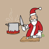 Santa cooking in kitchen Stock Photos
