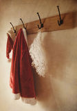 Santa costume hanging on coat rack Royalty Free Stock Photo