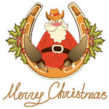 Santa in cowboy shoes sit on lucky horseshoe. Royalty Free Stock Photography
