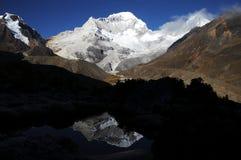 Santa Crus Chiko peak in Cordilleras. Reflection on the mountain in the lake stock photos