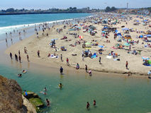Santa Cruz Beach on 4'th of July weekend. Lots of people come to celebrate summer at the beach. A hot day in Santa Cruz California Stock Photo