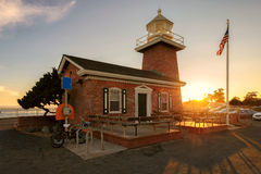 Santa Cruz lighthouse museum a memorial to surfers. Sunset at Santa Cruz lighthouse museum a memorial to surfers royalty free stock images