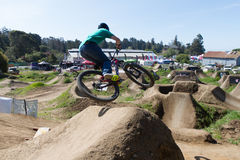 Santa Cruz Mountain Bike Festival - Post Office Jumps. Dropping into the Post Office jumps at the Santa Cruz Mountain Bike Festival Stock Image