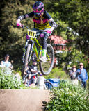 Santa Cruz Mountain Bike Festival - Post Office Jumps. Female competition at the Post Office jumps during the 2014 Santa Cruz Mountain Bike Festival in Aptos, CA Royalty Free Stock Photography
