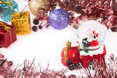 Santa Crystal snow ball on Christmas background Stock Photo