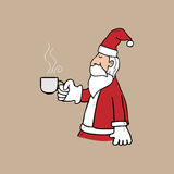Santa and cup of tea Royalty Free Stock Image