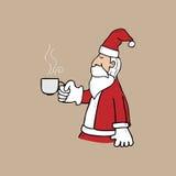 Santa and cup of tea Royalty Free Stock Image