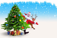 Santa dancing behind tree with reindeer Stock Image
