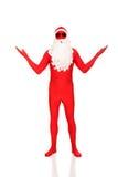 Santa dans l'habillement de latex montrant le copyspace Image libre de droits