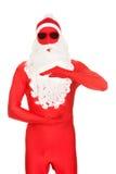 Santa dans l'habillement de latex tenant le copyspace Photos libres de droits