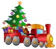 Santa dans le train avec les cadeaux et l'arbre de Noël Photo stock